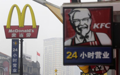 A McDonald's logo is seen next to a logo of KFC in Wuhan, Hubei province